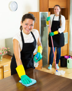 Smiling young women workers cleaning company ready to start work